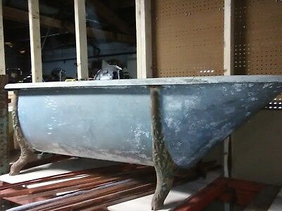 Antique Galvanized Cowboy style Bathtub with wooden trim iron legs
