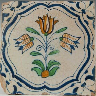 Nice Dutch Delft polychrome accolade tile, three tulip, 17th. century.