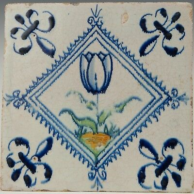 Nice Dutch Delft polychrome accolade tile, tulip in blue diamond, 17th. century.