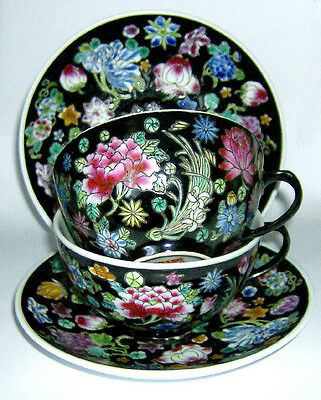 TWO  HAND painted Chinese CUPS & SAUCERS ( FLORAL on BLACK BACKGROUND pattern )