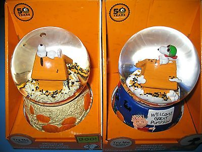 2 peanuts snomotion musical halloween waterglobes snoopy brand new in box