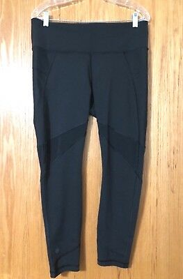 Womens ATHLETA black with mesh on front and back yoga pants size Large NICE