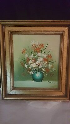 Oil Painting of daisies on board in a gold  wooden frame signed by Maury.