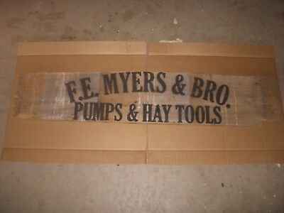 antique myers.water pumps/ antique hay trolley/ old wood sign