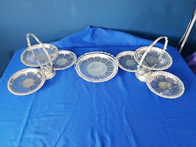 A Pair Of Elegant matching Silver Plated Cake Trays Plus Cake Dish with patterns