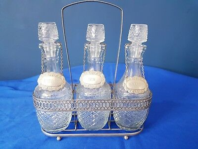 A Vintage Silver Plated/ Glass 3 Bottle Decanter Set With Lables.elegant.