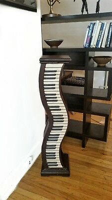 Vintage wood pedestal table shelf with wood carved piano keys