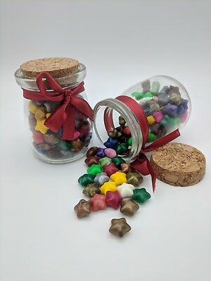 Glass Bottle Of Multicolored Star Shaped Sealing Wax Beads