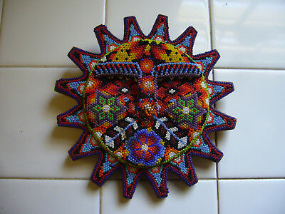 Mexican Beaded Folk Art Huichol Sun With Face On Wooden Plaque Trimmed In Blue