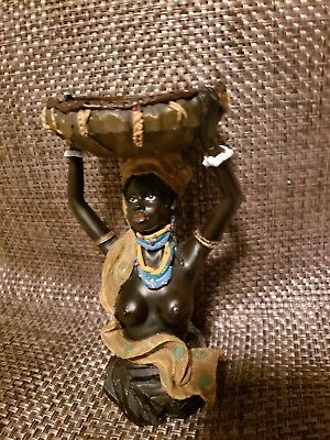 African woman candle holder statue