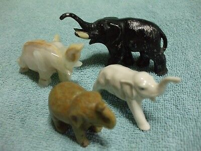 Lot of 4   Stone, Pewter and Ceramic Elephant Figurines