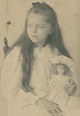 Young Girl With Long Dark Hair, Casual Pose, Holding Doll. Cabinet Card.