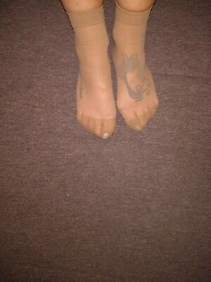 Worn ankle high tights