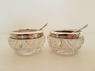 hallmarked glass salts, with silver rims and matchung spoons