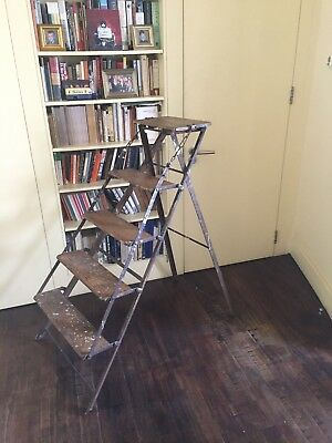 Vintage French wood and metal folding ladder with funky distressed appearance