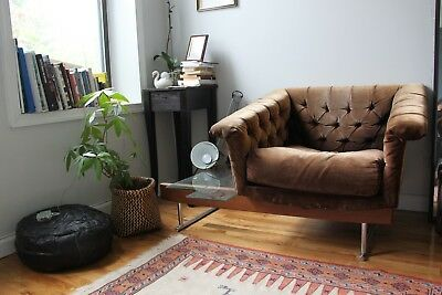 vintage brown velvet sofa couch with a glass table attached to it.