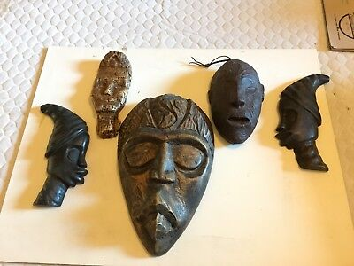 5 wooden masks from Haiti