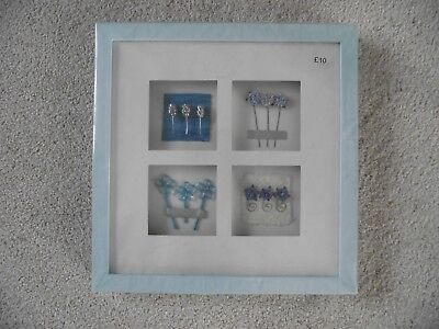 Pale blue square framed flower wall picture