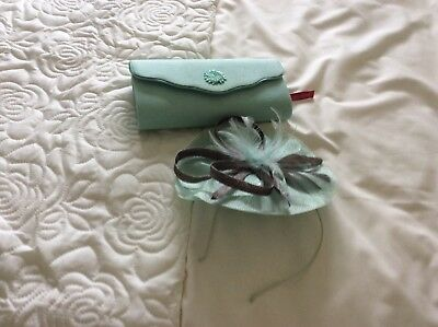Clutch bag with fascinator