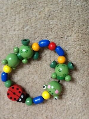 childs wooden frog and ladybird bracelet