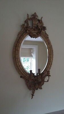 Pair of 19th Century gilt wood and gesso oval pier glasses or mirrors.