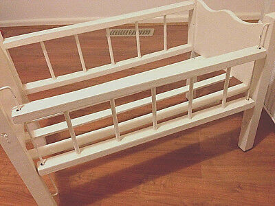 Dolls cot white wooden with retractable side that goes up and down PICK UP ONLY