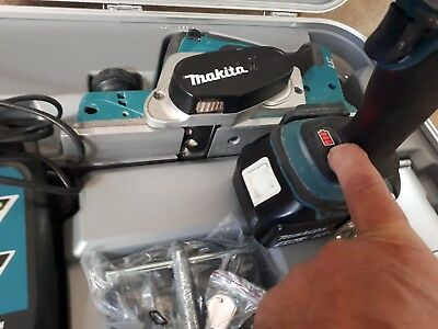 Makita 18 volt planer with 2 batteries, 1 charger, guide , new planer blades.
