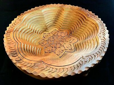 Nepalese Wooden Extendable Fruit Bowl made from one piece of wood.