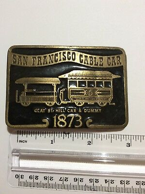SAN FRANCISCO BELT BUCKLE appears to be brass with black laquer