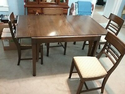 Antique dining table and chairs. Jefferson Wood Working Co. Louisville Kentucky.