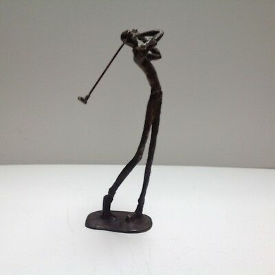 bronze abstract sculpture of man playing golf