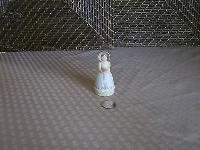 "Decorative bell woman holding flower figurine colorful design 3.25"" tall"