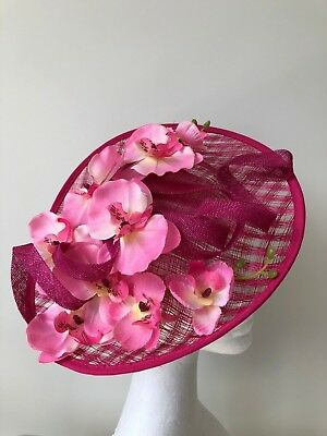 Pink saucer fascinator/hatinator with orchids and loops on a headband!