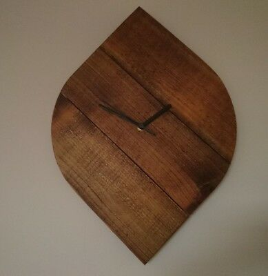 Unique rustic leaf shaped wooden clock with dark stain finish and black hands