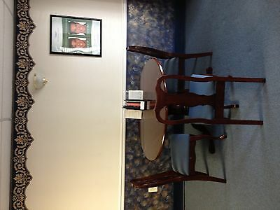 Gorgeous mahogany dining room table with four matching chairs