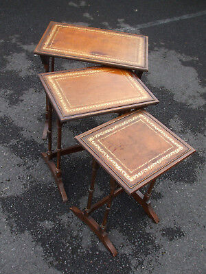 Vintage reproduction Regency style mahogany nest of tables, tooled leather tops