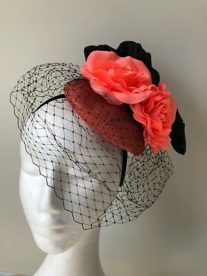 New coral fascinator with black loops and netting and coral flowers!