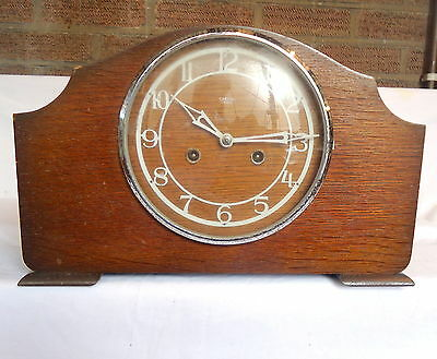 """""""SMITHS ENFIELD"""". Chiming Mantel Clock in Napolean Hat Style Case."""