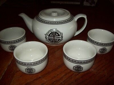Asian teapot with Chinese or Japanese writing vintage with 4 cups