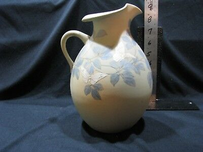 1886 Rookwood vase/pitcherwith butterflies. Created by Matt Daly, Shape #112.