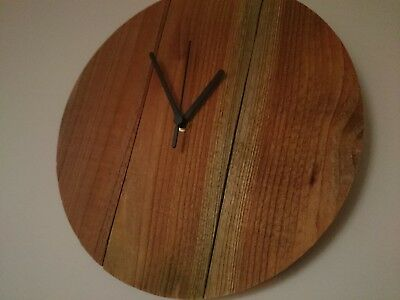 Unique rustic round wooden wall clock with teak oil finish and black hands