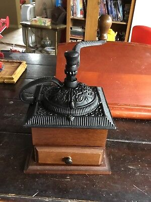 antique coffee grinder cast iron on wood
