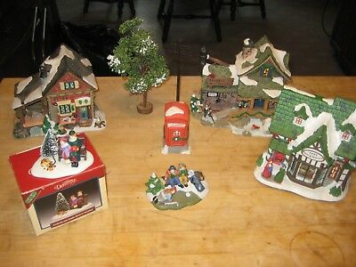 Great lot of 8 piece ( mostly ceramic) Christmas  village houses/ people