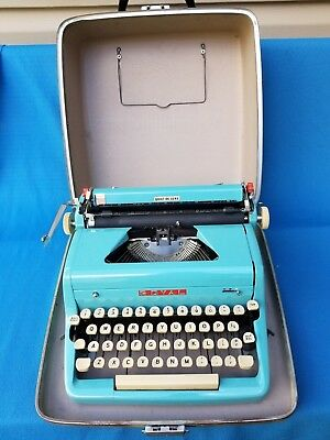 Vintage Royal Quiet Deluxe Blue Typewriter with Case