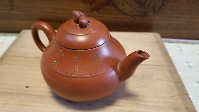 Chinese Yixing Zisha Clay Teapot With Inscriptions And Peaches On Lid