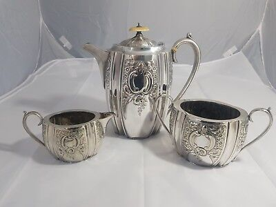 An Antique Embossed Silver Plated Tea Set By Pinder Brothers of sheffield.