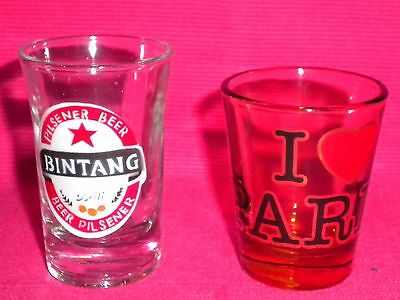 Shot Glasses x 2. 1 x 'I Love Paris' & 1 x 'Bintang'.