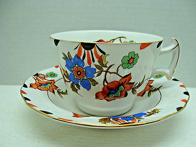 N. K. Porcelain co. Japan hand painted white and floral porcelain cup & saucer.