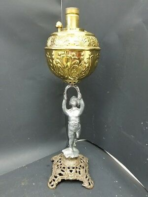 Antique Brass Banquet Oil Lamp with a Cherub Stem and Cast Metal Base