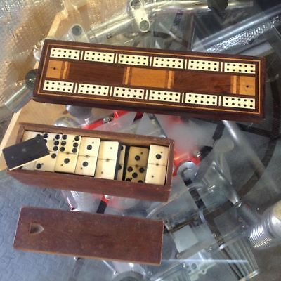 Antique bone and ebony domino's and an inlaid cribbage board with bun feet